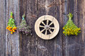 Vintage wooden wheel and medical herbs bunch Royalty Free Stock Photography