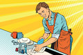 Vintage worker washes dishes