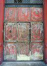 Vintage worn out antique entrance eroded closed door Royalty Free Stock Images