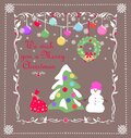 Vintage Xmas greeting handmade childish card with Christmas snowy tree, snowman, gift, hanging wreath and colorful balls Royalty Free Stock Photo