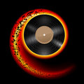 Vinyl disc with music notes flying out in spiral of flame color effect of rolling record illustration on black background Royalty Free Stock Image
