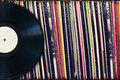 Vinyl record with copy space in front of a collection of albums (dummy titles) Royalty Free Stock Photo
