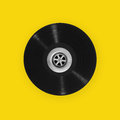 Vinyl record with plughole a black a in the centre on a yellow background Stock Images