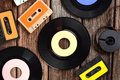 Vinyl record on the table disc and cassette tapes wooden Stock Photos
