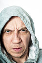 Violent hooded thug concept portrait of a male isolated against white Royalty Free Stock Photography