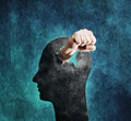 Violent mind conceptual image of a fist punching through a cardboard head Royalty Free Stock Images