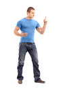 Violent young man threatening with finger full length portrait of a isolated on white background Stock Photo