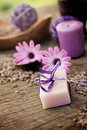 Violet dayspa nature set spa and wellness setting with natural soap candles and towel Royalty Free Stock Images