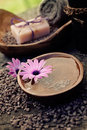 Violet dayspa nature set spa and wellness setting with natural soap candles and towel Royalty Free Stock Image