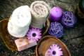 Violet dayspa nature set spa and wellness setting with natural soap candles and towel Stock Images