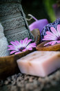 Violet dayspa nature set spa and wellness setting with natural soap candles and towel Stock Photos