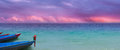 Violet oceon sky with parrot exotic ocean panorama a colorful cloudscape and boats a in similar harmonic colors Stock Photos