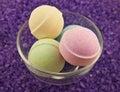 Violet  salt  and bath balls Royalty Free Stock Photo