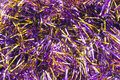 Violet tinsel garlands of christmas tree as a background Royalty Free Stock Photos