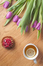 Violet tulips on the wood fresh wooden table vertical Royalty Free Stock Photo