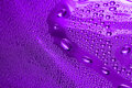Violet water drop Stock Image
