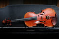 Violin on black piano. Royalty Free Stock Photo