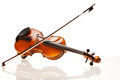 Violin with bow in front of a white background Royalty Free Stock Images