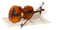 Violin and bow over a violin concerto book on a white background including clipping path Royalty Free Stock Images
