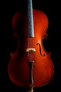 Violin in dark room Royalty Free Stock Photos