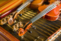 Violin detail with another one behind and cimbalom underneath Stock Photo