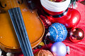 Violin and festive ornaments Stock Photography