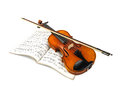 Violin and fiddle stick over score Stock Images