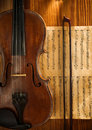 Violin and fiddlestick on note Stock Images