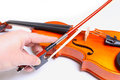 Violin and hand holding bow Stock Images