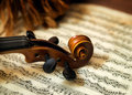 Violin head on sheet music Royalty Free Stock Photo