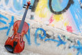 The violin leaning on wall graffiti drawn Stock Photography