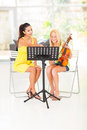 Violin lesson preteen girl having with her teacher at home Royalty Free Stock Photo