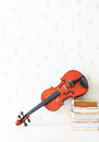 Violin lied on white table with old book beside Royalty Free Stock Photos