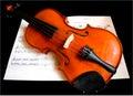Violin on a Music Sheet Royalty Free Stock Photo