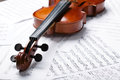 Violin on an notes background Stock Photo
