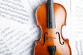 Violin on an notes background Stock Photos