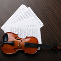Violin on an notes background Royalty Free Stock Image