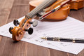 Violin, notes and pen. Royalty Free Stock Photo