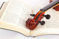 Violin with open book onwhite background Royalty Free Stock Photo