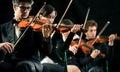 Violin orchestra performing Royalty Free Stock Photo