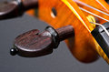 Violin part on black wooden background macro Royalty Free Stock Images