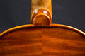 Violin part on black wooden background macro Stock Photo