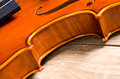 Violin part on black wooden background macro Stock Photography