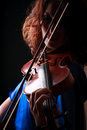 Violin playing violinist musician woman classical musical instrument player on black Royalty Free Stock Photos