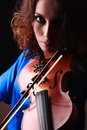 Violin playing violinist musician woman classical musical instrument player on black Stock Photos
