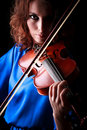 Violin playing violinist musician woman classical musical instrument player on black Stock Images