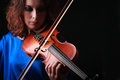 Violin playing violinist musician woman classical musical instrument player on black Stock Image