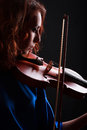 Violin playing violinist musician woman classical musical instrument player on black Royalty Free Stock Image