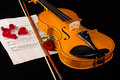 Violin sheet music and rose black composition still life Stock Photography