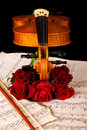 Violin sheet music and rose black composition still life Stock Photos